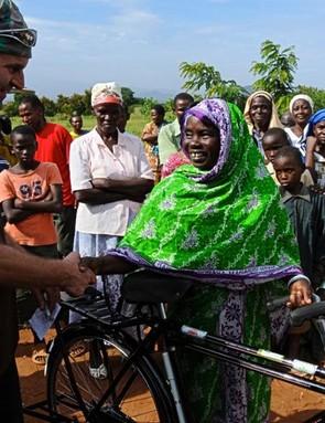 GT rider Hans Rey greets a villager in Tanzania