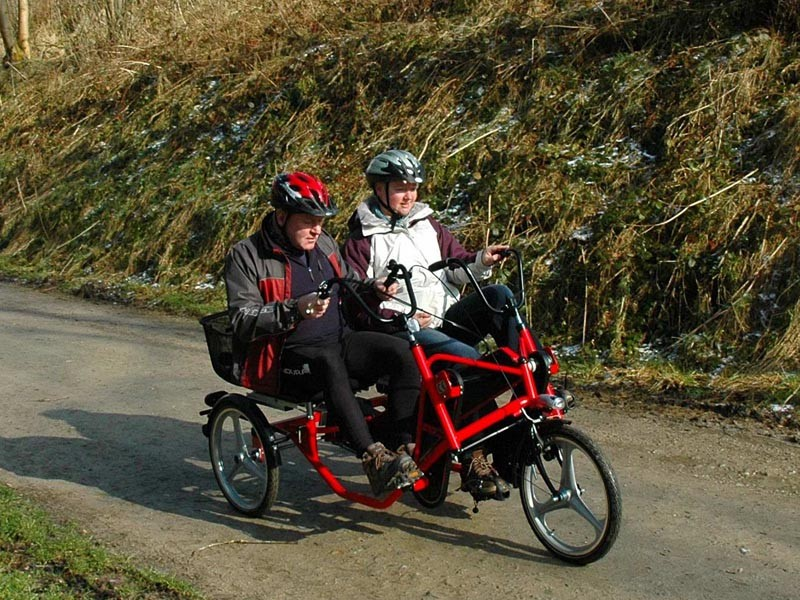 Richard and Ann Dixon from Scarborough in Dalby Forest using a special bike bought at last year's Disbability Bike Demo Day in the 3,440 hectare (8,600 acre) wood near Pickering, North Yorkshire.