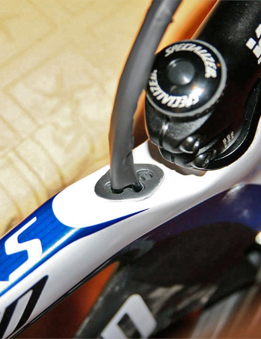 Internally routed cables enter the frame behind the stem in 'dirty' air. A fourth tube is on hand for power meter wire routing.