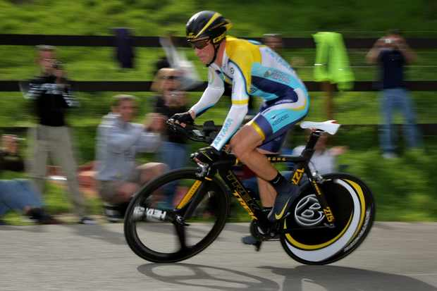 Lance Armstrong says he might ride his road bike in the Giro's 12th stage time trial