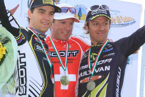 Nino Schurter (L) and teammate Florian Vogel on the podium at the recent Maremma Cup.
