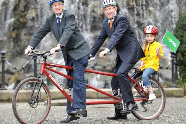 Pictured at the launch of the An Post Cycle Series are seven-year-old Clodagh Scully, John Tracy, CEO Irish Sports Council and Barney Whelan, An Post Director of Communications and Corporate Affairs.