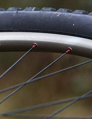Red anodized alu spoke nipples look great, but they're easy to round off and vulnerable to occasional seizing