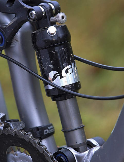 The own-brand rear shock lacks some adjustability, but is a good match for the Trance X5's suspension setup