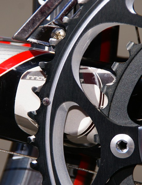 A small plate behind the chainrings  protect against damage in the event of a dropped chain or chainsuck.