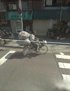 This chap carrying an unfeasible number of cans on his bike was spotted on Google Street View