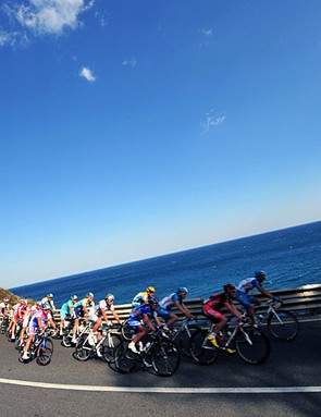 The peloton races along the coastline during the 100th Milan-San Remo