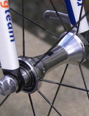 Shimano continue to use loose ball bearings as they feel their angular contact configuration is more durable and can run more smoothly than cartridges
