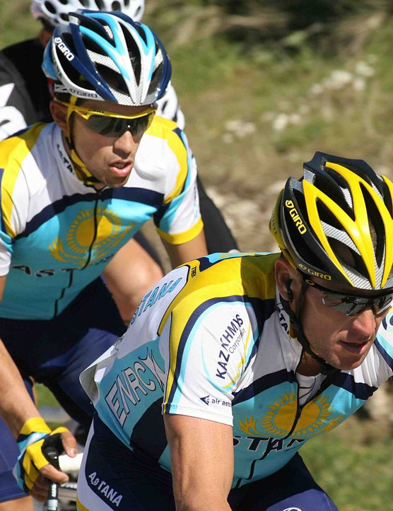 Astana teammates Alberto Contador (L) and Lance Armstrong race in Spain on March 23, 2009. Armstrong crashed out with 20km remaining.