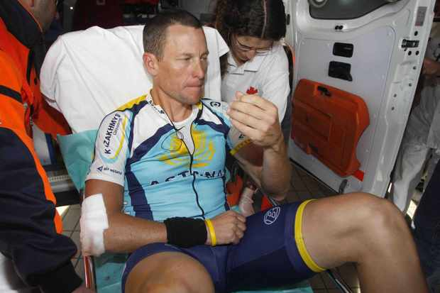 A very pained and subdued Lance Armstrong arrives at the Hospital Clinico of Valladolid after falling during the first stage of the 24th Vuelta Castilla y Leon between Paredes de Nava and Baltanas on March 23, 2009.