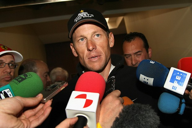 Lance Armstrong talks to reporters after leaving hospital on Monday evening