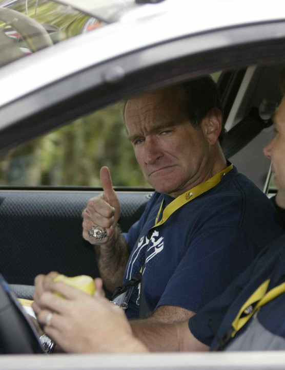 Actor Robin Williams shares a ride with Johan Bruyneel in the US Postal Cycling  Team car during the 2003 Tour de France.