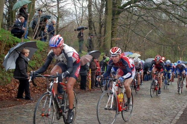 USA development rider Cole House (L) hammers up the Kemmelberg in Belgium.
