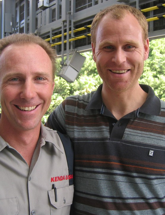 John Tomac (L) and company owner Joel Smith at the Interbike trade show.