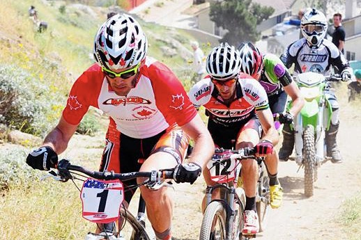 Geoff Kabush (Rocky Mountain/Maxxis) is chased by Max Plaxton (Shoair/Specialized) on March 29.