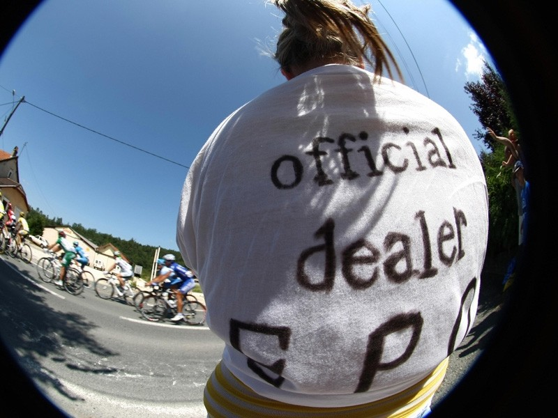 A fan at the Tour de France wearing an 'official dealer EPO' banner