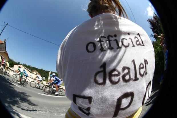 A fan at the Tour de France wearing an 'official dealer EPO' banner