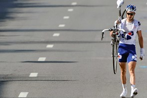 Anthony Geslin (FDJ) crosses the line on foot after crashing in the finale