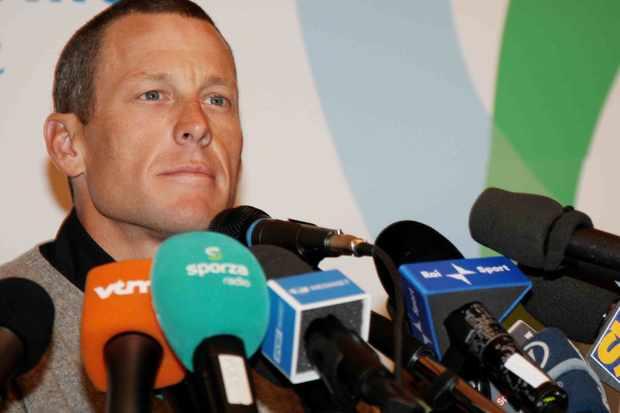 Lance Armstrong speaks during a pre Milan San-Remo press conference in Italy.