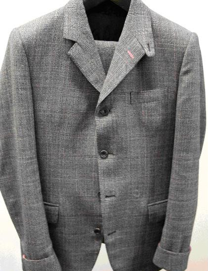 The suit is made of wool with a Prince of Wales check