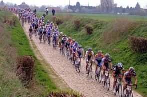 The peloton strung out on one of the early pave sectors