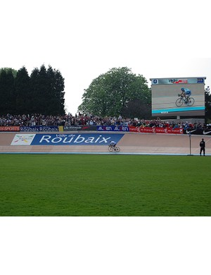Tom Boonen (Quick Step) solos into the Roubaix velodrome with nothing but open air ahead and behind.