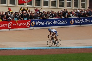 Boonen has no need to sprint but puts on a show for the throngs of fans in the stands.