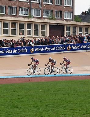 Johan Van Summeren (Silence-Lotto), Thor Hushovd (Cervélo TestTeam) and Leif Hoste (Silence-Lotto) enter the Roubaix velodrome…