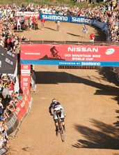 Minnaar thrills the crowds before crossing the finish line Sunday in South Africa.