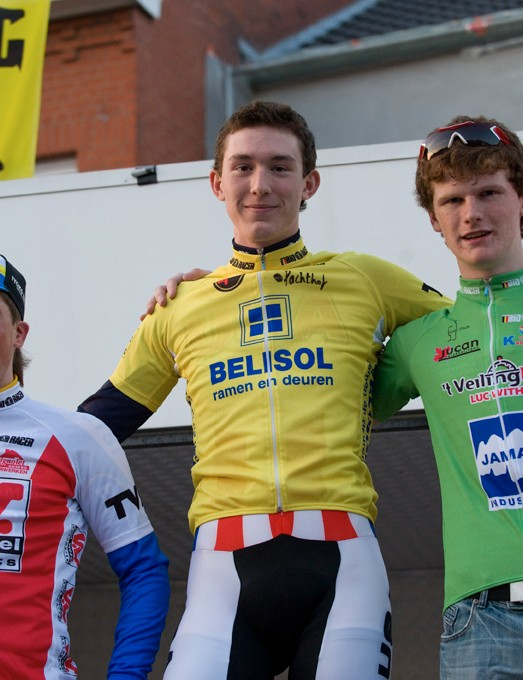Adam Leibovitz wears the yellow leader's jersey on the podium following the prologue of the Ster Van Zuid Limburg.