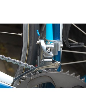 A steel cage on a SRAM Red front derailleur body adds rigidity compared to the stock titanium unit