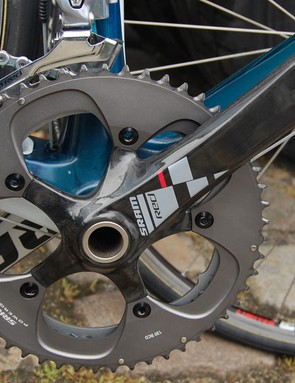 This Astana team bike crankset was fitted with the usual upsized inner chainring - but shouldn't that little tab be behind the crankarm?