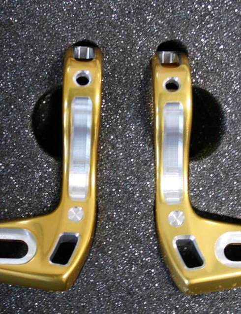 You want a pair of gold alloy shifter brackets, sir? No problem. That'll be £69.99 please