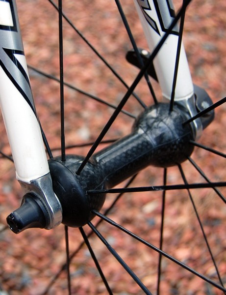 The straight-pull spokes are anchored to carbon fibre hub bodies both front…