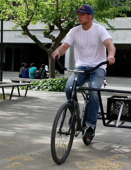 San Jose State University junior Warren White demos his team's side-car cart in the Art Quad April 13, 2009.