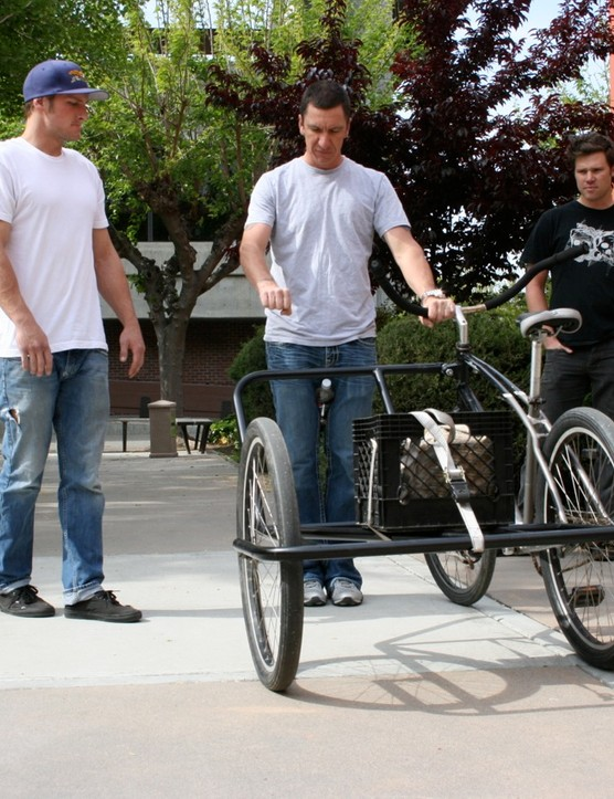 Specialized's chief design director Robert Egger (C) talks with students Warren White, Shane Siemer and Danny Yu.