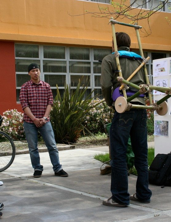 Specialzied's Greg Grenzke (R) trys out the Cameroon-friendly portable backpack/dolly.