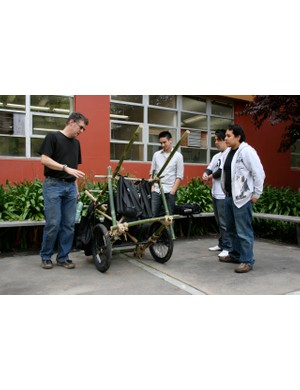 San Jose State University design professor John McClusky (L) discusses the merits of the market cart.