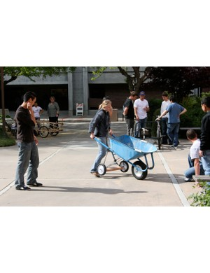 Students demo their ridable wheelbarrow concept.