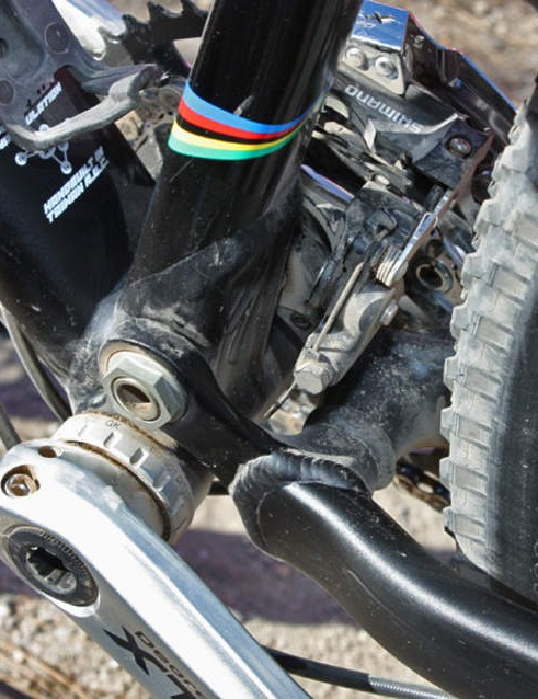 The main swingarm pivot is integrated into the bottom bracket shell.
