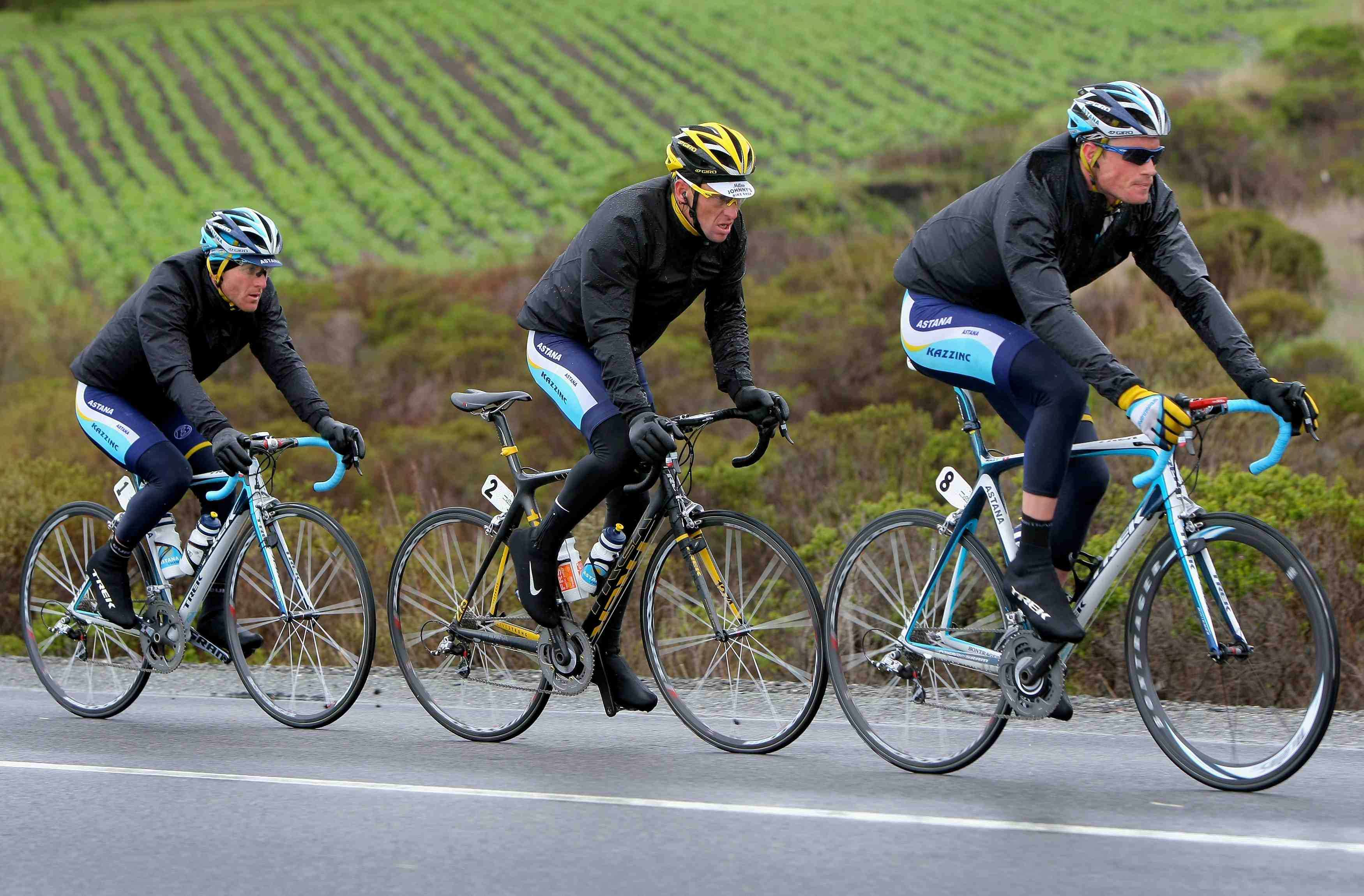 Under the veil of black rain jackets are Astana teammates Levi Leipheimer, Lance Armstrong and Gregory Rast during the 2009 Tour of California.