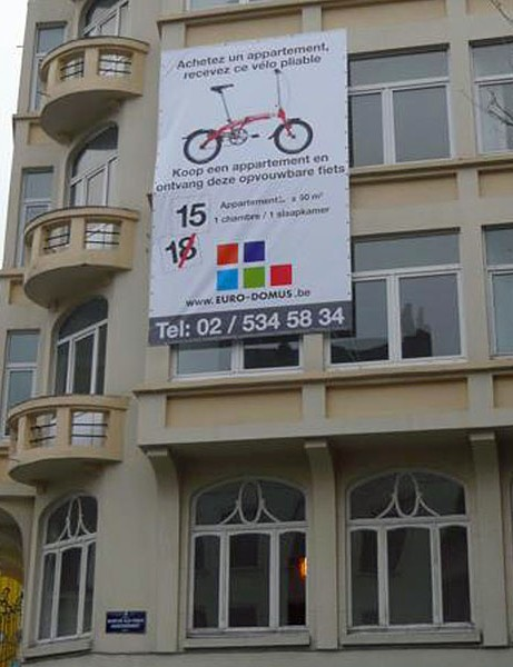 People who buy apartments in this Brussels block will receive a free 'mobility gift' - a Dahon bike