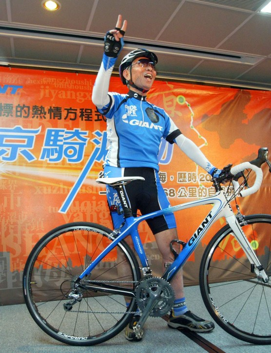 Giant Bicycle Chairman King Liu and the special edition Giant Defy Advanced that the 75-year-old will ride from Beijing to Shanghai beginning May 9, 2009.