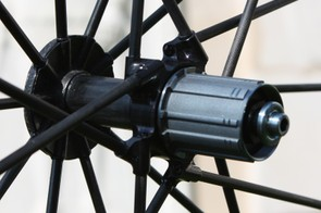 Both front and rear hub shells are all carbon fibre and the entire structure is co-moulded together, leaving no mechanical joints to add weight