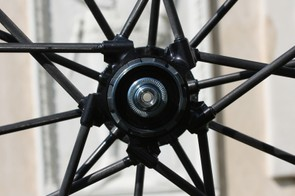 The rear wheel's 20 spokes are laced one-cross on the driveside and radial on the other