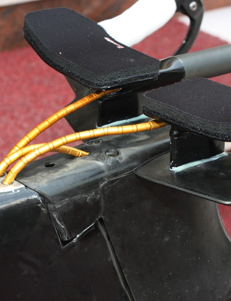 The internally routed cables enter the frame directly behind the stem.