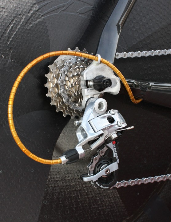 Rear entry dropouts afford an adjustable tire gap at the seat tube and the little loop on the top keeps the flexible Nokon derailleur housing out of the way.