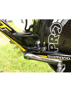 The rear brake is tucked in behind the seat tube.
