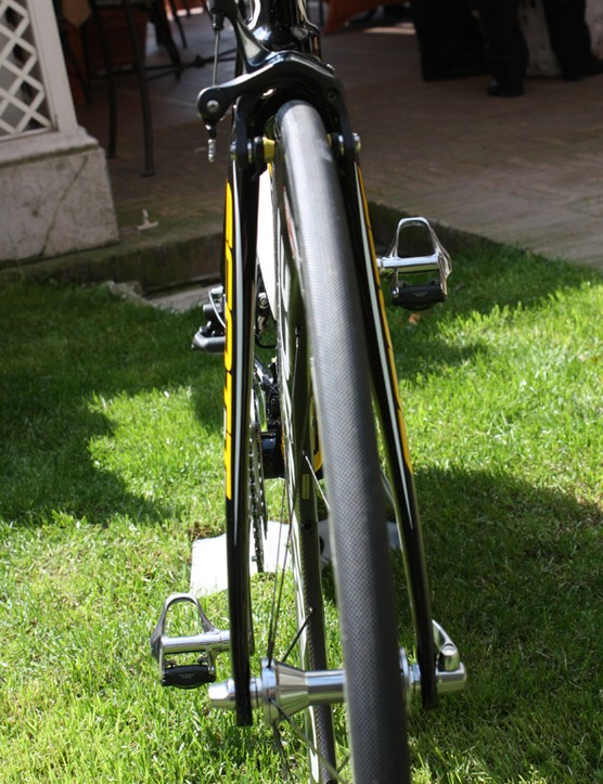 The fork blades are set fairly far away from the spinning spokes apparently as a way to reduce pressure drag.