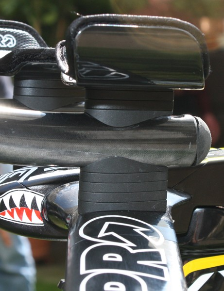 The bar extensions are adjustable in height by swapping spacers.